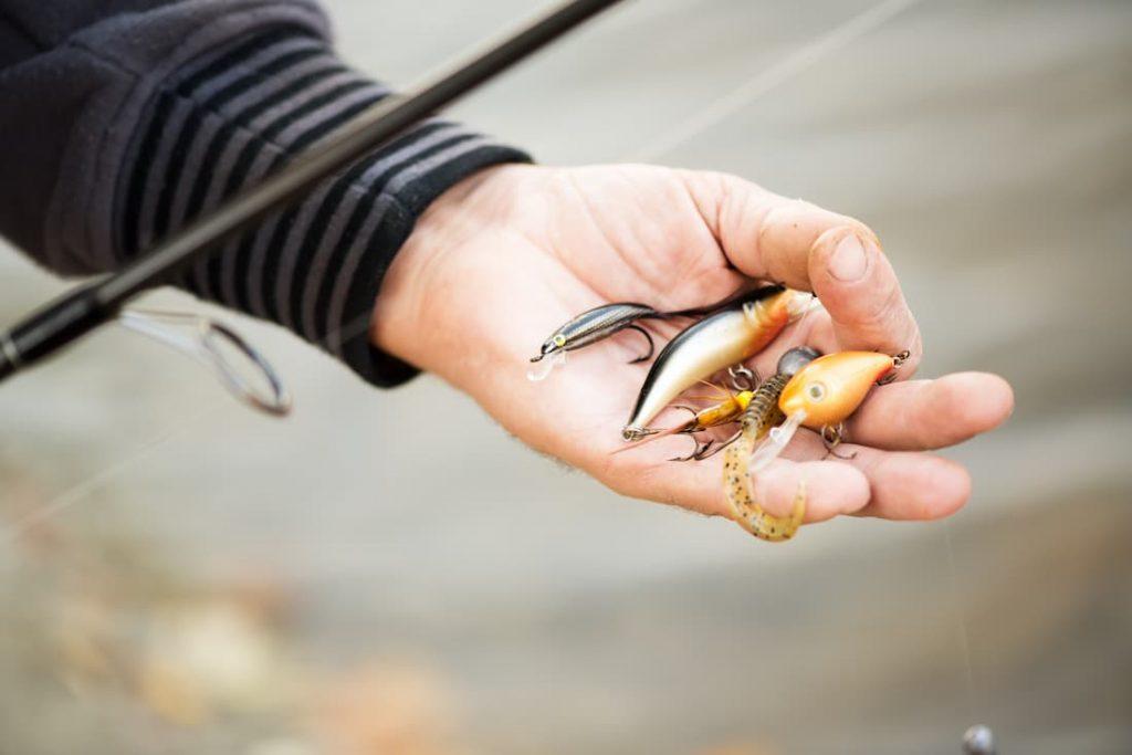 Man holding fishing lures