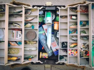 Open tackle box full of winter bass lures