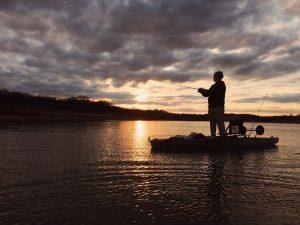 Man fishing from a kayak.